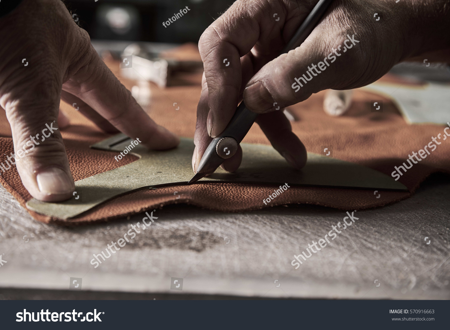 stock-photo-shoe-production-process-in-factory-570916663.jpg